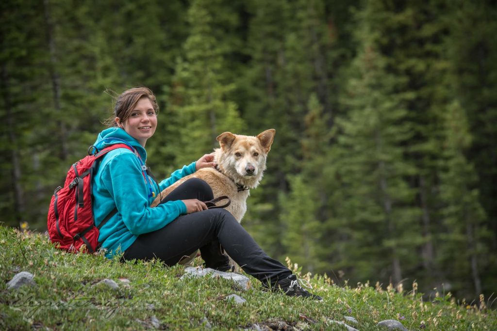 Hiker and her dog at Rae Glacier