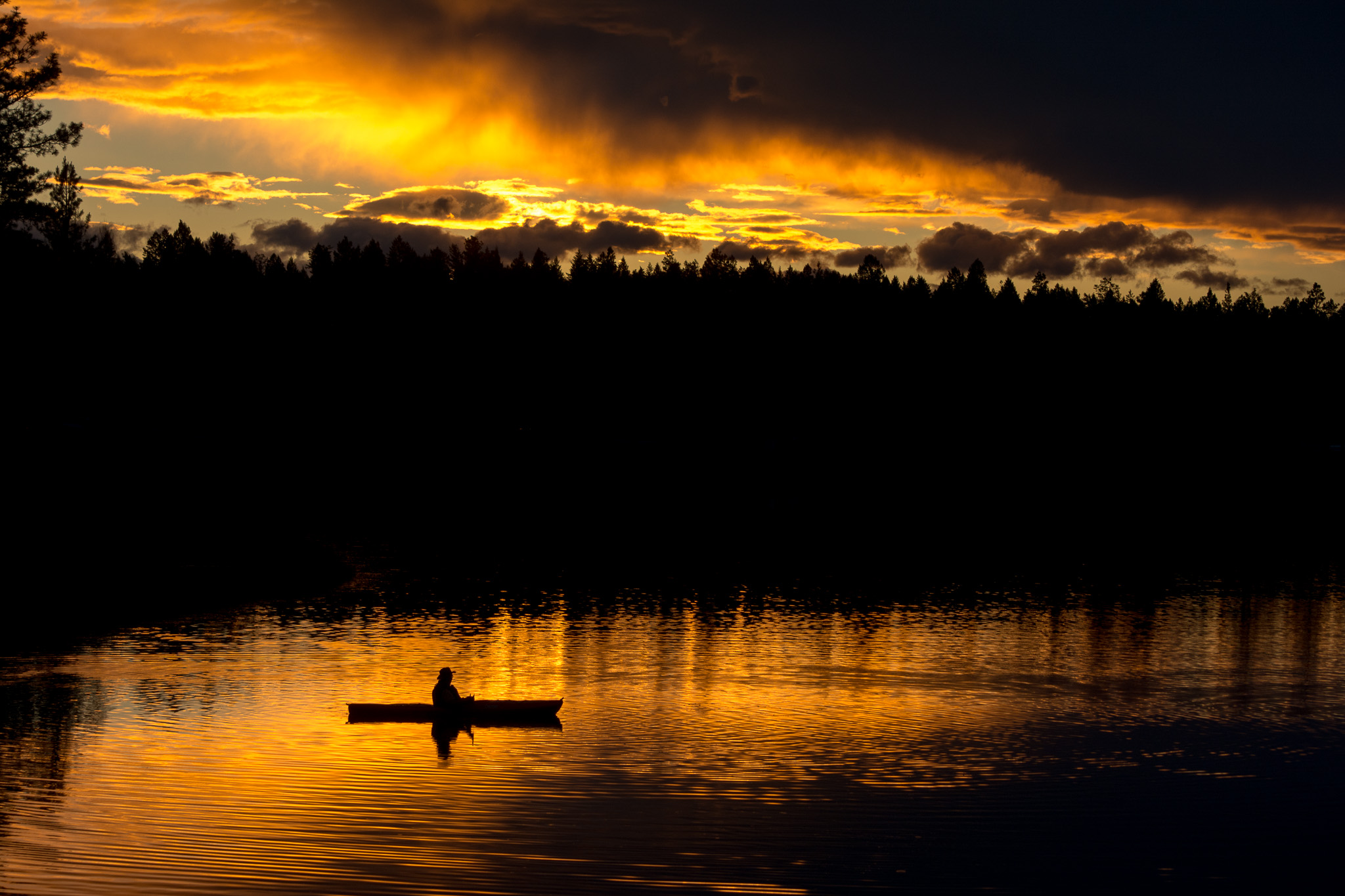 lake sunset with canoe