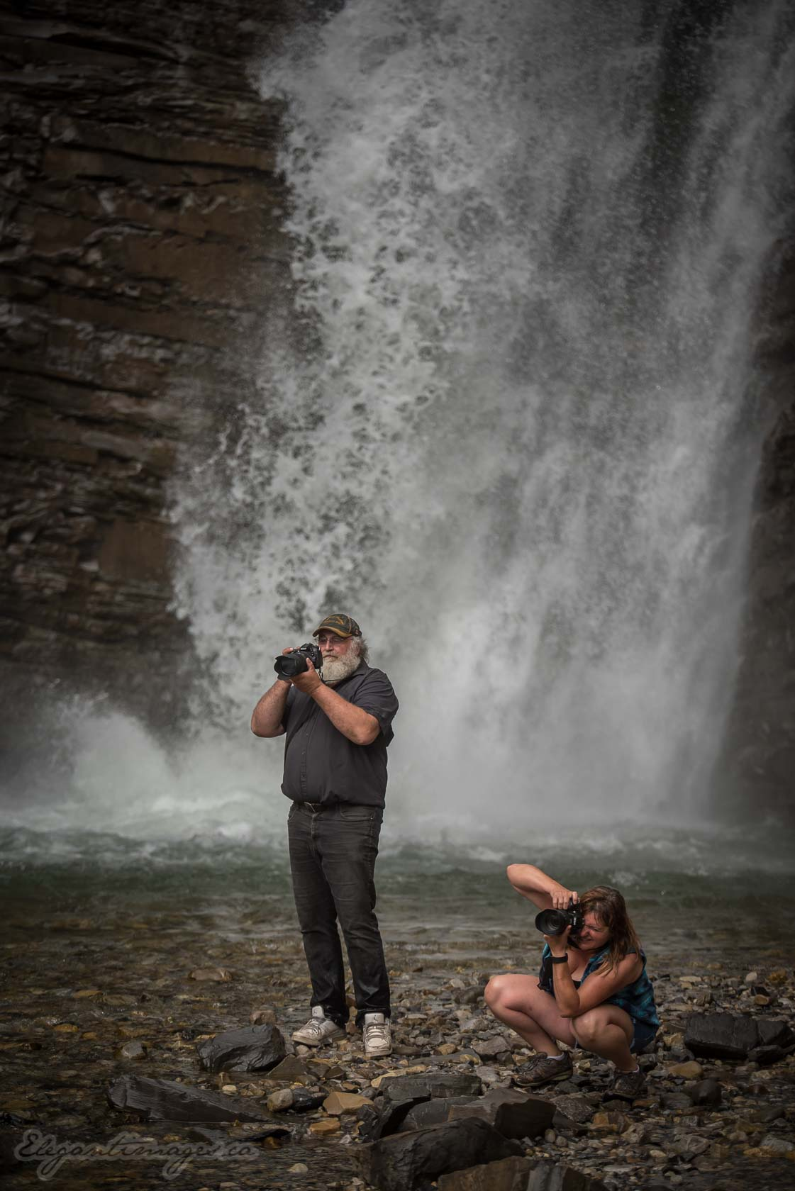 Bighorn Falls hike- Ya Ha Tinda- Photographers standing in the falls