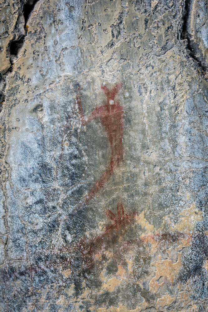 Ancient Pictographs on grotto canyon wall