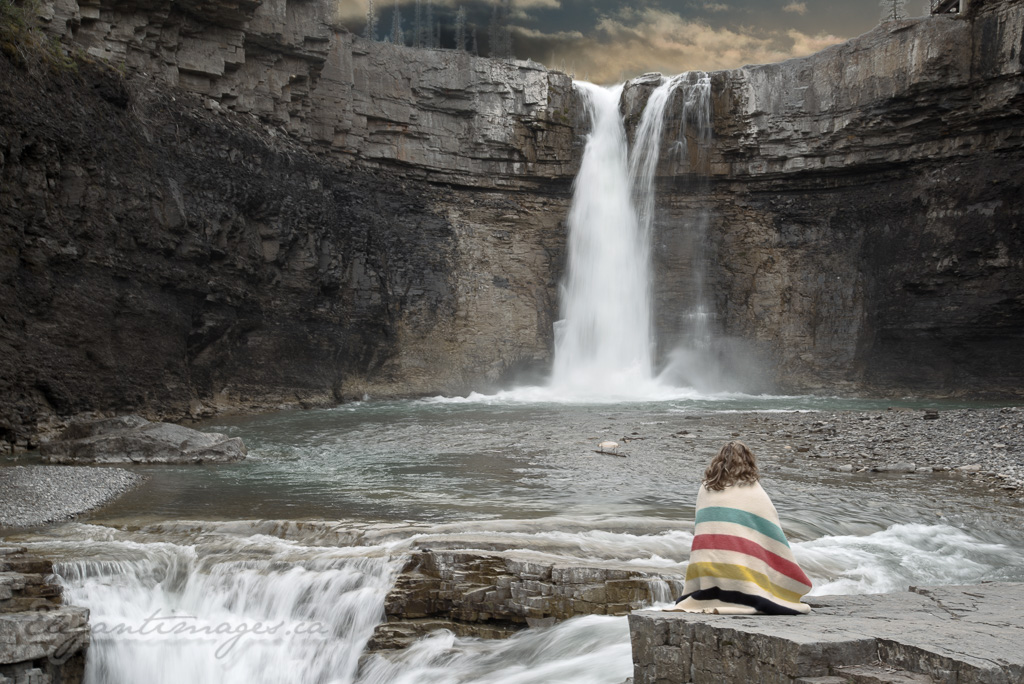 Crescent Falls with a model wearing a Hudson Bay Blanket by the falls