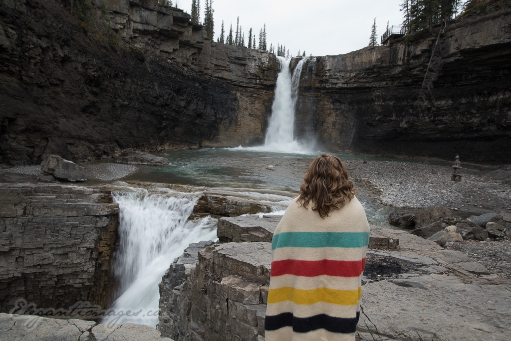 Crescent Falls model standing nearby wearing a Hudson Bay Banket